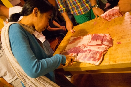 cutting up the pork belly